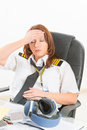 Tired woman airline pilot in the office Royalty Free Stock Photo