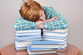 Tired woman and books Royalty Free Stock Photo