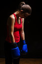 Tired woman boxer low light Royalty Free Stock Photo