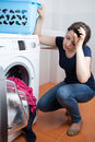 Tired woman during doing housework young vertical Royalty Free Stock Image