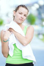 Tired woman after fitness time and exercising in city street par Royalty Free Stock Photo