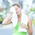 Tired woman after fitness time and exercising in Royalty Free Stock Photo