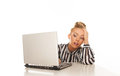 Tired woman in front of laptop Royalty Free Stock Image