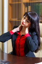 Tired woman in  office holding hands on the aching neck Royalty Free Stock Photo