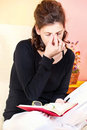 Tired woman of reading book Stock Images