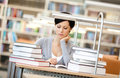 Tired woman reads at the library Stock Image