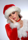 Tired woman in Santa costume Royalty Free Stock Image