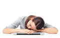 Tired woman sleeping on laptop young over white background Royalty Free Stock Photos