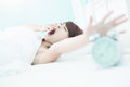Tired woman touch alarm clock Royalty Free Stock Photo