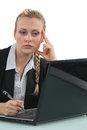Tired woman working at a laptop Royalty Free Stock Images