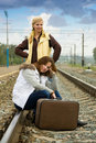 Tired women on rail station Royalty Free Stock Photo