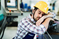 Tired worker fall asleep during working hours in factory Royalty Free Stock Photo