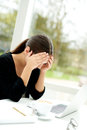 Tired worried woman resting her head in her hands Royalty Free Stock Photo
