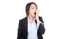 Tired young asian businesswoman yawn isolated on white background Royalty Free Stock Images