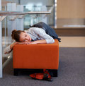 Tired young business woman asleep at workplace Royalty Free Stock Photos