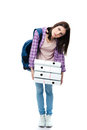 Tired young female student with backpack and folders Royalty Free Stock Photo