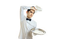Tired of the young waiter with tray put his hand with a napkin on his head Royalty Free Stock Photo