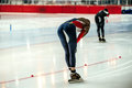 Tired young women speed skaters Royalty Free Stock Photo
