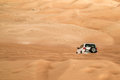 Tires tracks on sand dunes dune bashing in uae desert Stock Images