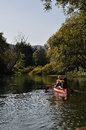 Tirino river and kayak kayaking on during estate Royalty Free Stock Photos