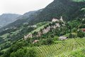 Tirol castle and the fountain castle view from village near merano italy totyrol church of st peter with vineyards Royalty Free Stock Images