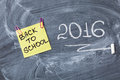 Title Back to school on piece of paper and title 2016 written by chalk on the chalkboard