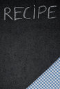 Title recipe written in chalk on a blackboard and napkin the corner vertical Royalty Free Stock Image