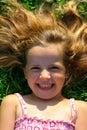 Tittering little girl Royalty Free Stock Photo