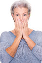To be amazed about something senior woman ist in front of white background Stock Photos