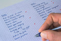 To do list concept of balancing work and life close up of a man s hand with a pen keeping track of a handwritten of home and work Stock Photography