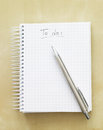 To do list notebook and pen with a blue tint Royalty Free Stock Image