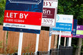 To let sign uk estate agent signs advertising property in Stock Images