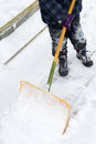 To shovel snow in winter time Stock Photography