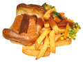 Toad in the hole and chips with mixed vegetables gravy isolated on a white background Stock Image