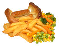 Toad in the hole and chips with mixed vegetables isolated on a white background Royalty Free Stock Photos