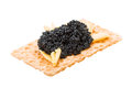 Toast with black caviar isolated on white background Royalty Free Stock Photo