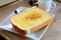 Toast bread with butter and sugar on white plate ready to eat c coffee break Stock Photography