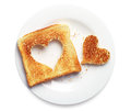 Toast bread with cut out heart shape slice of in a plate on white background Royalty Free Stock Photography