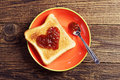 Toast bread with jam in shape of hearts on wooden background top view Stock Photo