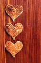 Toast bread in shape of hearts on wooden background Royalty Free Stock Photography