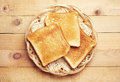 Toast bread in a wicker plate on wooden background top view Royalty Free Stock Image