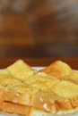 Toast with butter and sprinkling with sugar close up Royalty Free Stock Photo