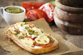 Toast with cheese and basil pesto and tomato Stock Image