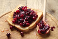 Toast with cranberry jam on a cutting board Royalty Free Stock Photos