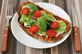 Toast with cream cheese, lettuce and tomato Royalty Free Stock Photo
