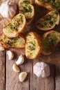 Toast with fresh herbs and garlic  vertical top view closeup Royalty Free Stock Photo