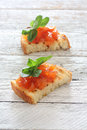 Toast with fruit jam toasts over wood background Stock Images