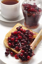 Toast with jam and jar cranberry cup of tea Royalty Free Stock Images