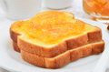 Toast with marmalade toasted white bread orange white dishes horizontal composition Stock Images