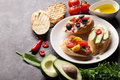 Toast sandwiches with avocado tomatoes and olives on stone background Royalty Free Stock Image